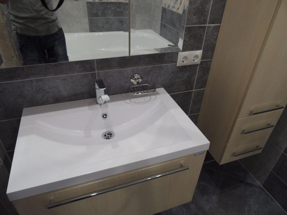 Комфортный микроклимат в ванной поддерживается тёплым полом