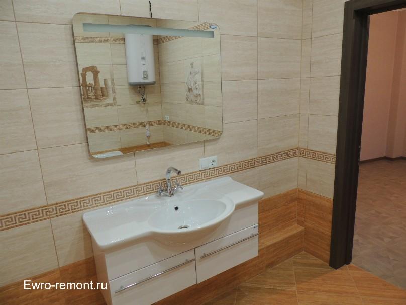 подвесная мойка и зеркало в ванной